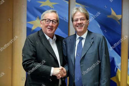 European Commission President Jean-Claude Juncker (L) welcomes Paolo Gentiloni (R), Euroepan Commissioner-designate for Economy, ahead of a meeting at the European Commission in Brussels, Belgium, 15 October 2019.