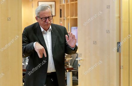 European Commission President Jean-Claude Juncker steps out of his office to welcome Paolo Gentiloni (not pictured) European Commissioner-designate for Economy, ahead of a meeting at the European Commission in Brussels, Belgium, 15 October 2019.