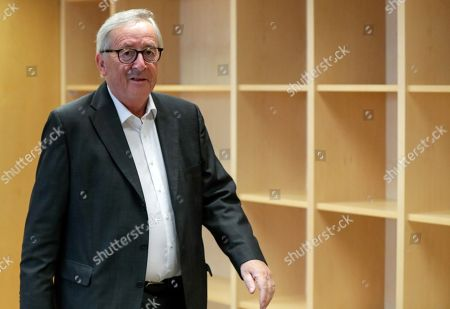 Stock Image of European Commission President Jean-Claude Juncker steps out of his office to welcome Paolo Gentiloni (not pictured) European Commissioner-designate for Economy, ahead of a meeting at the European Commission in Brussels, Belgium, 15 October 2019.