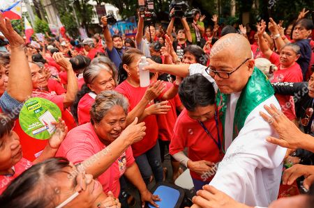 """Catholic priest Father Robert Reyes meets with supporters of former Senator Ferdinand """"Bongbong"""" Marcos Jr. during a rally in support of Philippine Vice President Leonor Robredo outside the Supreme Court in Manila, Philippines on . In their statement, the Supreme Court sitting as Presidential Electoral Tribunal has decided to release to the parties of former senator Ferdinand """"Bongbong"""" Marcos Jr. and Vice President Robredo the report on revision and appreciation of ballots in the 3 pilot provinces and for them to comment. The son of the late dictator, Marcos, has filed an electoral protest against Vice President Robredo which he accused of cheating in the 2016 elections"""