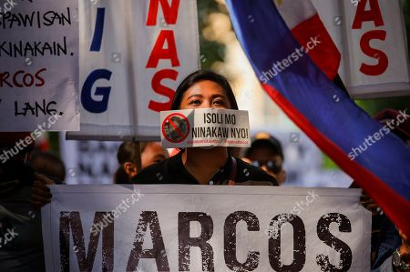 """Stock Picture of Activists and supporters of Philippine Vice President Maria Leonor """"Leni"""" Robredo display a slogan that reads """"You return what you stole"""" during a rally outside the Supreme Court in Manila, Philippines on . In their statement, the Supreme Court sitting as Presidential Electoral Tribunal has decided to release to the parties of former senator Ferdinand """"Bongbong"""" Marcos Jr. and Vice President Robredo the report on revision and appreciation of ballots in the 3 pilot provinces and for them to comment. The son of the late dictator, Marcos, has filed an electoral protest against Vice President Robredo which he accused of cheating in the 2016 elections"""