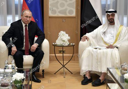 Russian President Vladimir Putin (L) and Abu Dhabi's Crown Prince Sheikh Mohammed bin Zayed Al Nahyan (R) meet at the Qasr Al Watan palace in Abu Dhabi, United Arab Emirates, 15 October 2019. Russian President Vladimir Putin is on a state visit to UAE.