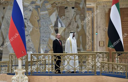 Russian President Vladimir Putin (L) and Abu Dhabi's Crown Prince Sheikh Mohammed bin Zayed Al Nahyan (R) attend an official welcome ceremony at the Qasr Al Watan palace in Abu Dhabi, United Arab Emirates, 15 October 2019. Russian President Vladimir Putin is on a state visit to UAE.