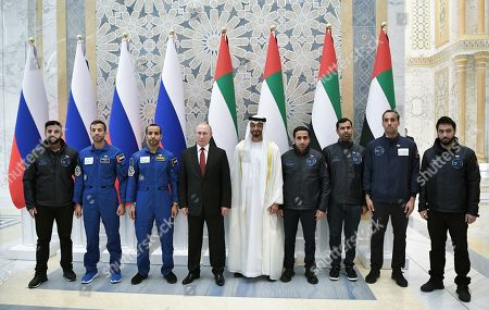 Russian President Vladimir Putin (4-L) and Abu Dhabi's Crown Prince Sheikh Mohammed bin Zayed Al Nahyan (C) pose for a picture with UAE astronauts Sultan Al Neyadi (2-L) and Hazza Al Mansouri (3-L) during a meeting at the Qasr Al Watan palace in Abu Dhabi, United Arab Emirates, 15 October 2019. Russian President Vladimir Putin is on a state visit to UAE.