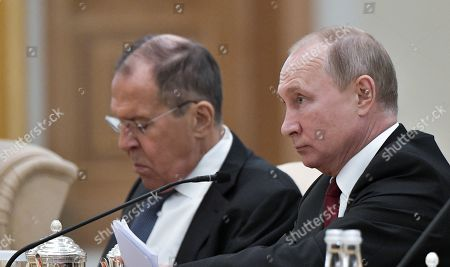 Russian President Vladimir Putin (R) and Russian Foreign Minister Sergei Lavrov (L) attend talks with Abu Dhabi's Crown Prince Sheikh Mohammed bin Zayed Al Nahyan  (not pictured) at the Qasr Al Watan palace in Abu Dhabi, United Arab Emirates, 15 October 2019. Russian President Vladimir Putin is on a state visit to UAE.