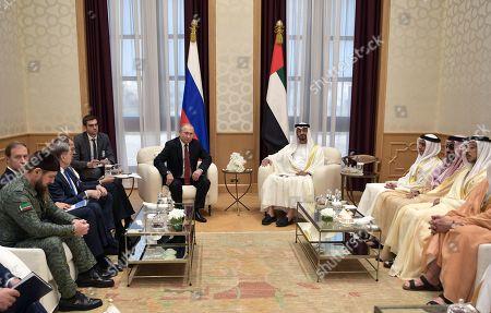 Russian President Vladimir Putin (C-L) and Abu Dhabi's Crown Prince Sheikh Mohammed bin Zayed Al Nahyan (C-R) meet at the Qasr Al Watan palace in Abu Dhabi, United Arab Emirates, 15 October 2019. Russian President Vladimir Putin is on a state visit to UAE.