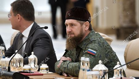Head of the Chechen Republic Ramzan Kadyrov (R) attends a meeting of Russian President Vladimir Putin and Abu Dhabi's Crown Prince Sheikh Mohammed bin Zayed Al Nahyan (both not pictured) at the Qasr Al Watan palace in Abu Dhabi, United Arab Emirates, 15 October 2019. Russian President Vladimir Putin is on a state visit to UAE.