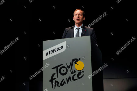 Stock Photo of Tour de France director Christian Prudhomme delivers a speech during the presentation of the Tour de France 2020 cycling race, in Paris, . The 107th edition of the race starts on June 27 2019 to end on the Champs-Elysees avenue on July 19