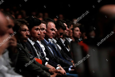Britain's Chris Froome, center, attends the presentation of the Tour de France 2020 cycling race, in Paris, . The 107th edition of the race starts on June 27 2019 to end on the Champs-Elysees avenue on July 19
