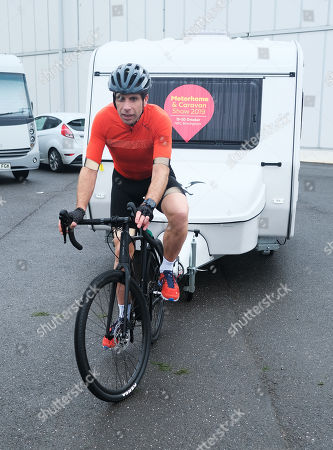 Mark Beaumont, endurance cyclist tows a caravan with his bicycle