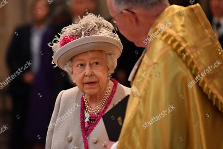 Queen Elizabeth II arrives to attend a service to mark the 750th anniversary of Westminster Abbey in London