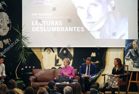 US writer Siri Hustvedt (C) delivers a speech as she holds a meeting with high school students at the IES Alfonso II high school in Oviedo, Asturias, northern Spain, 15 October 2019. Hustvedt will be awarded 2019 Princess of Asturias Award for Literature during the prizes awarding ceremony running in the city next 18 October. The banner reads 'Stunning Readings'.