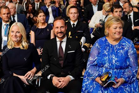 (L-R) Norwegian Crown Princess Mette-Marit, Crown Prince Haakon and Prime Minister of Norway Erna Solberg attend the opening ceremony at the book fair Frankfurter Buchmesse 2019, in Frankfurt am Main, Germany, 15 October 2019. The 71th edition of the international Frankfurt Book Fair, described as the world's most important fair for the print and digital content business, runs from 16 to 20 October and gathers authors, writers and celebrities from all over the world.