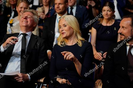 (L-R) Director of Frankfurt Book Fair, Juergen Boos, Norwegian Crown Princess Mette-Marit and Crown Prince Haakon attend the opening ceremony at the book fair Frankfurter Buchmesse 2019, in Frankfurt am Main, Germany, 15 October 2019. The 71th edition of the international Frankfurt Book Fair, described as the world's most important fair for the print and digital content business, runs from 16 to 20 October and gathers authors, writers and celebrities from all over the world.