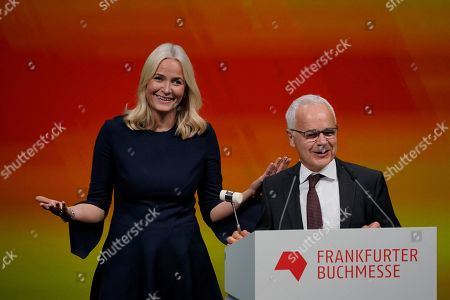 Norwegian Crown Princess Mette-Marit and Heinrich Riethmueller, chair of the German Publishers and Booksellers Association open the fair with the traditional hammer strike during the opening ceremony at the book fair Frankfurter Buchmesse 2019, in Frankfurt am Main, Germany, 15 October 2019. The 71th edition of the international Frankfurt Book Fair, described as the world's most important fair for the print and digital content business, runs from 16 to 20 October and gathers authors, writers and celebrities from all over the world.