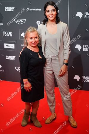 Stock Image of (L-R) German actress Christine Urspruch and actress Pegah Ferydoni arrive for the opening ceremony at the book fair Frankfurter Buchmesse 2019, in Frankfurt am Main, Germany, 15 October 2019. The 71th edition of the international Frankfurt Book Fair, described as the world's most important fair for the print and digital content business, runs from 16 to 20 October and gathers authors, writers and celebrities from all over the world.