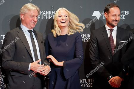 (L-R) Director of Frankfurt Book Fair, Juergen Boos, Norwegian Crown Princess Mette-Marit and Crown Prince Haakon arrives for the opening ceremony at the book fair Frankfurter Buchmesse 2019, in Frankfurt am Main, Germany, 15 October 2019. The 71th edition of the international Frankfurt Book Fair, described as the world's most important fair for the print and digital content business, runs from 16 to 20 October and gathers authors, writers and celebrities from all over the world.