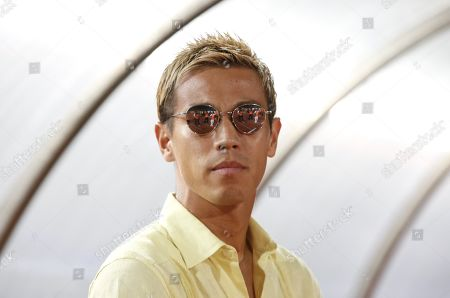 Stock Photo of Cambodian national soccer team's Japanese head coach Keisuke Honda during the FIFA World Cup 2022 qualifying soccer match between Cambodia and Iraq in Phnom Penh, Cambodia, 15 October 2019.