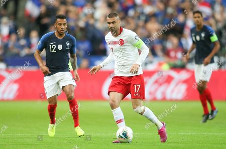Turkish captain Burak Yilmaz controls the ball pressured by Franc's Corentin Tolisso