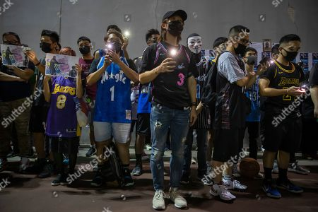 Demonstrators sing the U.S. national anthem during a rally at the Southorn Playground in Hong Kong, . Protesters in Hong Kong have thrown basketballs at a photo of LeBron James and chanted their anger about comments the Los Angeles Lakers star made about free speech during a rally in support of NBA commissioner Adam Silver and Houston Rockets general manager Daryl Morey, whose tweet in support of the Hong Kong protests touched off a firestorm of controversy in China