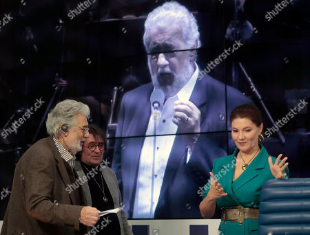 Spanish tenor Placido Domingo (L) with Russian altist and conductor Yuri Bashmet (R), welcomed by Russian singer Oksana Shilova (R) arrives for a press conference at TASS agency in Moscow, 15 October 2019. Placido Domingo will give a single concert at Crocus City Hall together with an orchestra Novaya Rossiya (New Russia) conducted by Yuri Bashmet and with Russian opera singers mezzo-soprano Maria Katayeva and soloist of Mariinsky theater soprano Oksana Shilova.