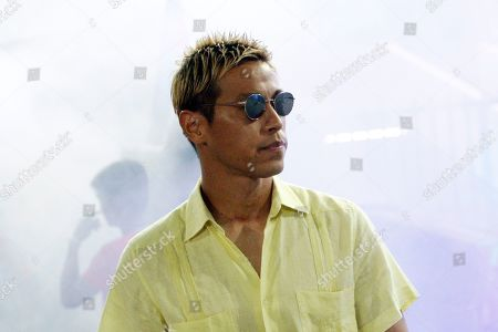 Stock Picture of Cambodia's manager Keisuke Honda walks before the World Cup second round Group C qualifying soccer match between Cambodia and Iraq in Cambodia National Stadium, in Phnom Penh, Cambodia, . Iraq won 4-0