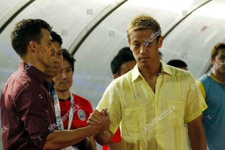 Cambodia's manager Keisuke Honda, right, shakes hands upon his arrival at the World Cup second round Group C qualifying soccer match between Cambodia and Iraq in Cambodia National Stadium, in Phnom Penh, Cambodia, . Iraq won 4-0