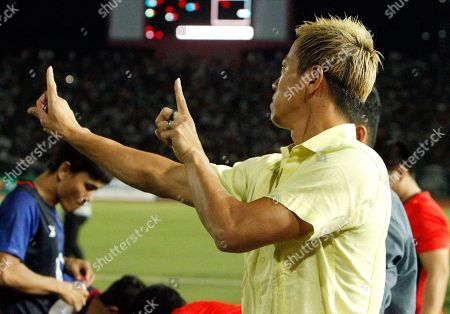 Stock Image of Cambodia's manager Keisuke Honda, right, gestures before the World Cup second round Group C qualifying soccer match between Cambodia and Iraq in Cambodia National Stadium, in Phnom Penh, Cambodia, . Iraq won 4-0