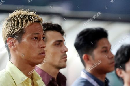 Cambodia's manager Keisuke Honda, left, looks on before the World Cup second round Group C qualifying soccer match between Cambodia and Iraq in Cambodia National Stadium, in Phnom Penh, Cambodia, . Iraq won 4-0