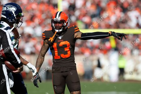 Cleveland Browns wide receiver Odell Beckham (13) points toward the bench against the Seattle Seahawks during an NFL football game, in Cleveland