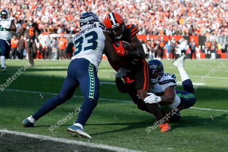 Jarvis Landry, Mychal Kendricks, Tedric Thompson. Cleveland Browns wide receiver Jarvis Landry (80) is plays against Seattle Seahawks linebacker Mychal Kendricks (56) and Tedric Thompson (33) during the second half of an NFL football game, in Cleveland
