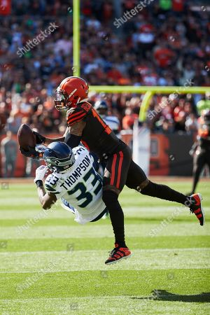 Cleveland Browns wide receiver Odell Beckham Jr. (13) makes a reception over Seattle Seahawks free safety Tedric Thompson (33) during an NFL football game in Cleveland