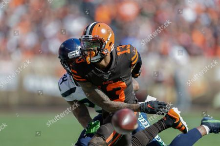 Stock Photo of Seattle Seahawks cornerback Jamar Taylor (24) breaks up a pass intended for Cleveland Browns wide receiver Odell Beckham Jr. (13) during the first half of an NFL football game, in Cleveland