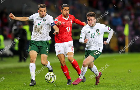 Switzerland vs Republic of Ireland. Ireland's Seamus Coleman and Aaron Connolly with Ricardo Rodriguez of Switzerland