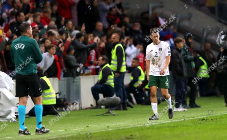 Switzerland vs Republic of Ireland. Ireland's Seamus Coleman leaves the field after receiving a red card
