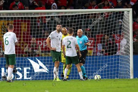 Switzerland vs Republic of Ireland. Ireland's Seamus Coleman remonstrates with referee Szymon Marciniak