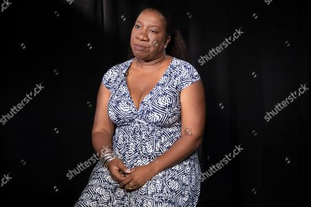 Tarana Burke, founder and leader of the #MeToo movement, sits for a portrait in New York. Burke is using the second anniversary of the movement to launch a new effort intended to mobilize voters heading into the 2020 election. The new hashtag #MeTooVoter was unveiled Tuesday, Oct. 15 on the same day as the fourth Democratic presidential debate and reflects a frustration among activists that issues of sexual violence and harassment have largely been absent from the debate stage and campaign trail