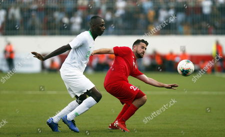 Stock Photo of Palestine's Mohammed Khalil (R) vies for the ball with Saudi Arabia's Salman Alfaraj (L) during the Asian qualifiers soccer match for the FIFA 2022 World Cup between Palestine and Saudi Arabia at the Faisal Husseini Stadium, in the West Bank city of Ramallah, 15 October 2019.