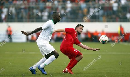 Stock Picture of Palestine's Mohammed Khalil (R) vies for the ball with Saudi Arabia's Salman Alfaraj (L) during the Asian qualifiers soccer match for the FIFA 2022 World Cup between Palestine and Saudi Arabia at the Faisal Husseini Stadium, in the West Bank city of Ramallah, 15 October 2019.