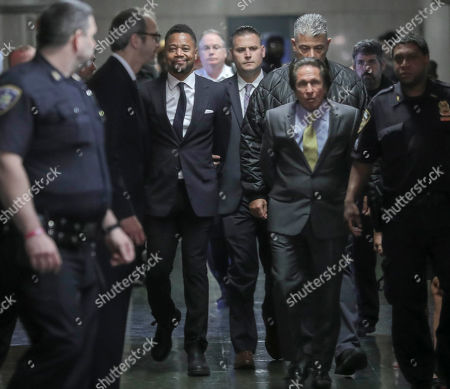 Cuba Gooding Jr., third from left, is escorted handcuffed as he arrives in court to face sexual misconduct charges, in New York. Gooding Jr. pleaded not guilty to an indictment alleging two instances of sexual misconduct. The new charge involves an alleged incident in October 2018. The defense paints it as a shakedown attempt