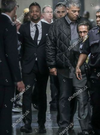 Cuba Gooding Jr., second from left, is escorted handcuffed as he arrives in court to face sexual misconduct charges, in New York. Gooding Jr. pleaded not guilty to an indictment alleging two instances of sexual misconduct. The new charge involves an alleged incident in October 2018. The defense paints it as a shakedown attempt
