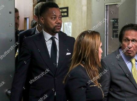 Cuba Gooding Jr., left, follows his legal team from court after he pleaded not guilty to sexual misconduct charges, in New York. The new charge involves an alleged incident in October 2018. The defense paints it as a shakedown attempt