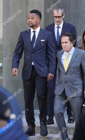 Cuba Gooding Jr., left, leaves court with his legal team including lead attorney Mark Haller, right, after pleading not guilty to sexual misconduct charges, in New York