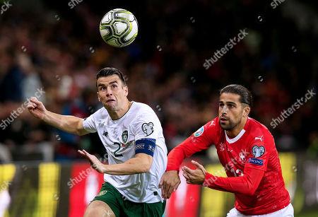 Switzerland vs Republic of Ireland. Ireland's Seamus Coleman with Ricardo Rodriguez of Switzerland