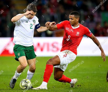 Switzerland vs Republic of Ireland. Ireland's Seamus Coleman with Manuel Akanji of Switzerland