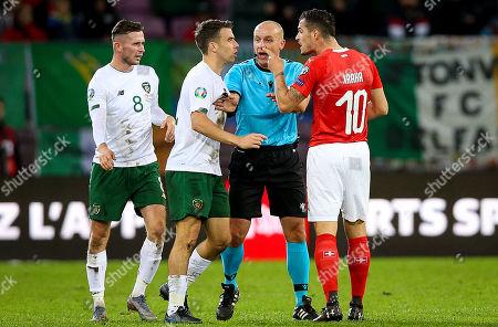 Switzerland vs Republic of Ireland. Ireland's Seamus Coleman with Granit Xhaka of Switzerland