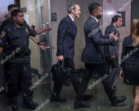 Cuba Gooding Jr., third from right, gives a thumbs up as he leaves court, after he plead not guilty to sexual misconduct charges, in New York
