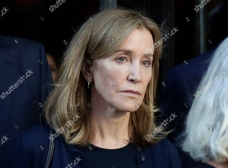 Stock Picture of Actress Felicity Huffman leaving federal court after her sentencing in a nationwide college admissions bribery scandal in Boston. A representative for Huffman says she reported to a federal prison in California to serve a two-week sentence on Tuesday, Oct. 15. Last month a federal judge in Boston sentenced Huffman to 14 days in prison, a $30,000 fine, 250 hours of community service and a year's probation after she pleaded guilty to fraud conspiracy for paying an admissions consultant $15,000 to have a proctor correct her daughter's SAT answers