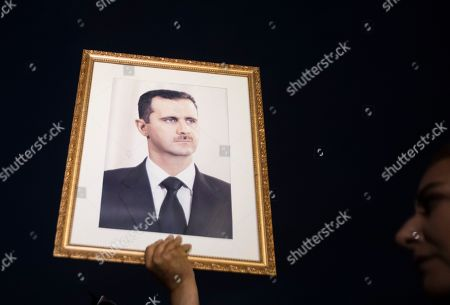 A supporter of Syrian President Bashar al-Assad holds his portrait during a demonstration next to the Syrian Embassy in Amman, Jordan, 15 October 2019. About 200 people gathered at the Syrian Embassy in Amman to denounce the Turkish offensive on the Kurdish part of the Syrian territory at its border.