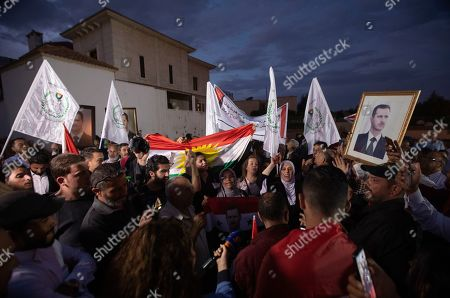 Supporters of Syrian President Bashar al-Assad hold his portrait and shout slogans during a demonstration next to the Syrian Embassy in Amman, Jordan, 15 October 2019. About 200 people gathered at the Syrian Embassy in Amman to denounce the Turkish offensive on the Kurdish part of the Syrian territory at its border.